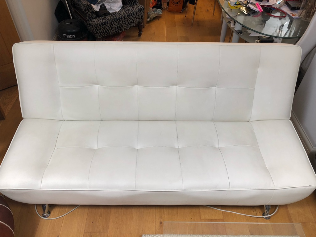 White faux leather click clack sofabed