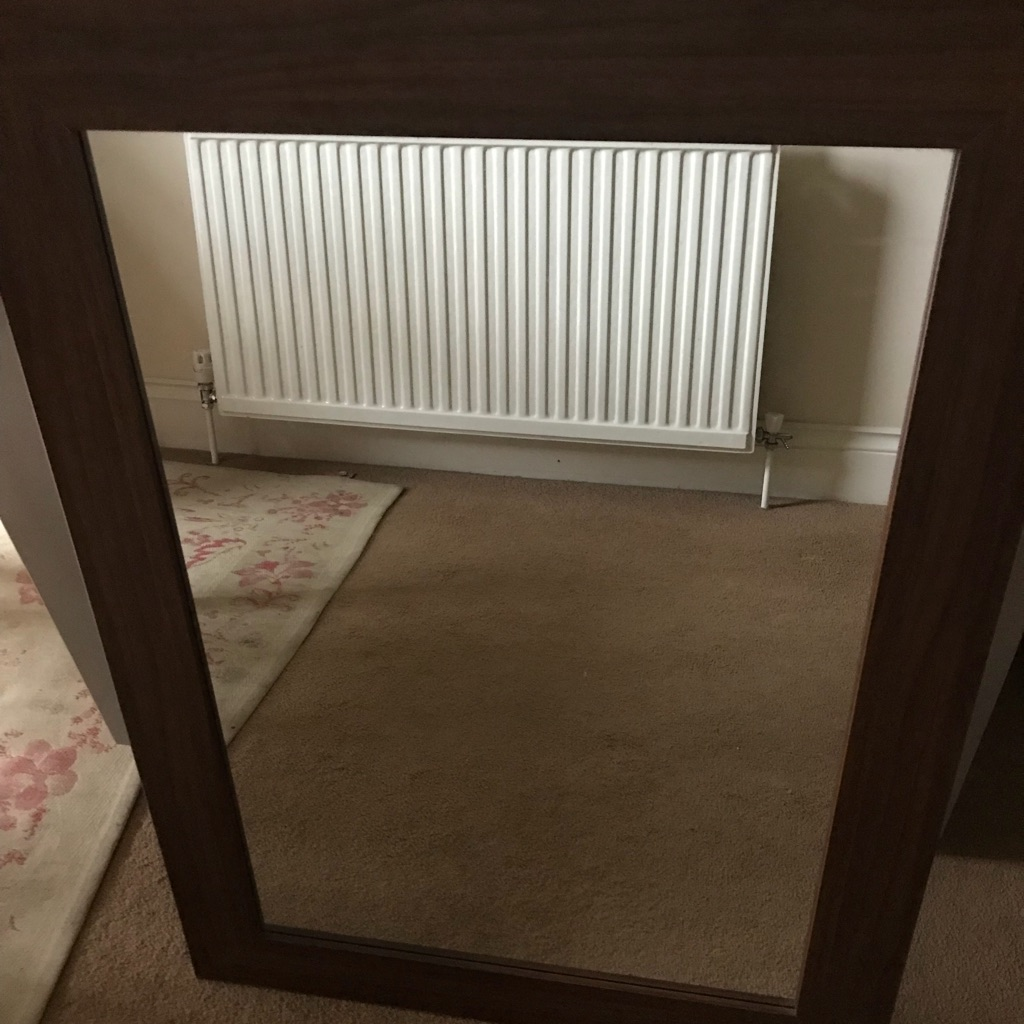 Dark wooden framed mirror