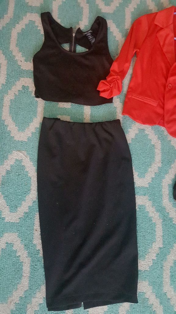 Black pencil skirt and crop top with red blazer