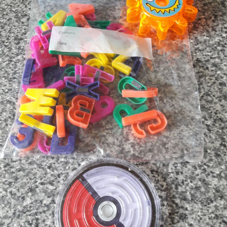 Bag of magnetic letters and numbers