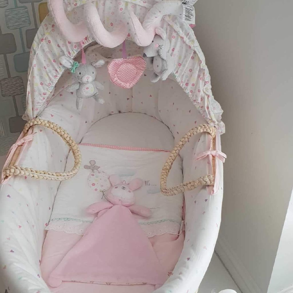 Mother care Moses basket.