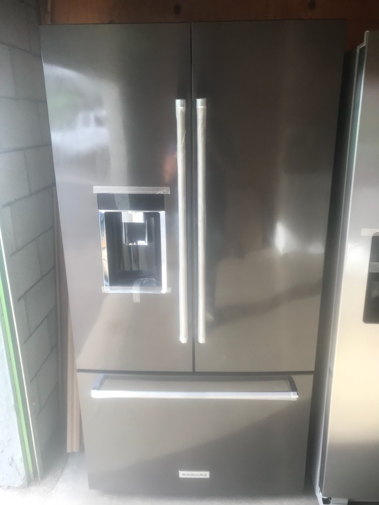 New kitchenAid black stainless steel fridge