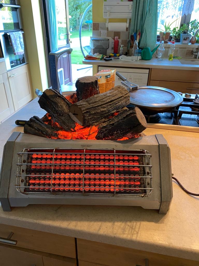 Vintage Belling electric log effect fire. 50 years old. Still works ok.