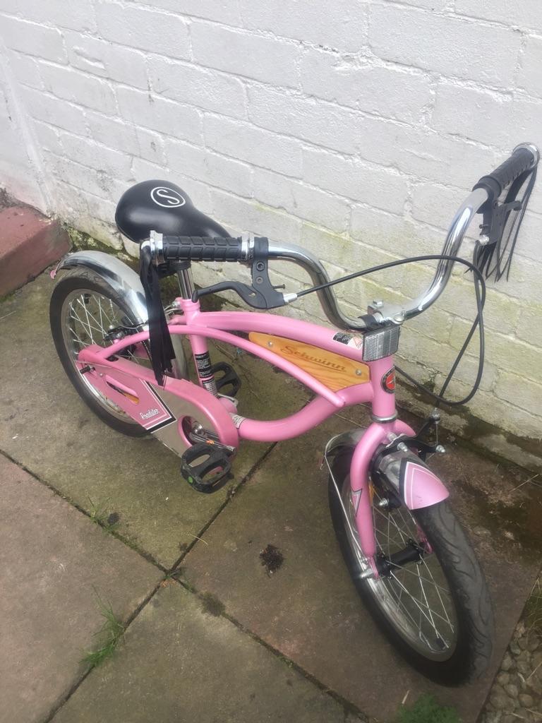 Schwinn pink and black bike