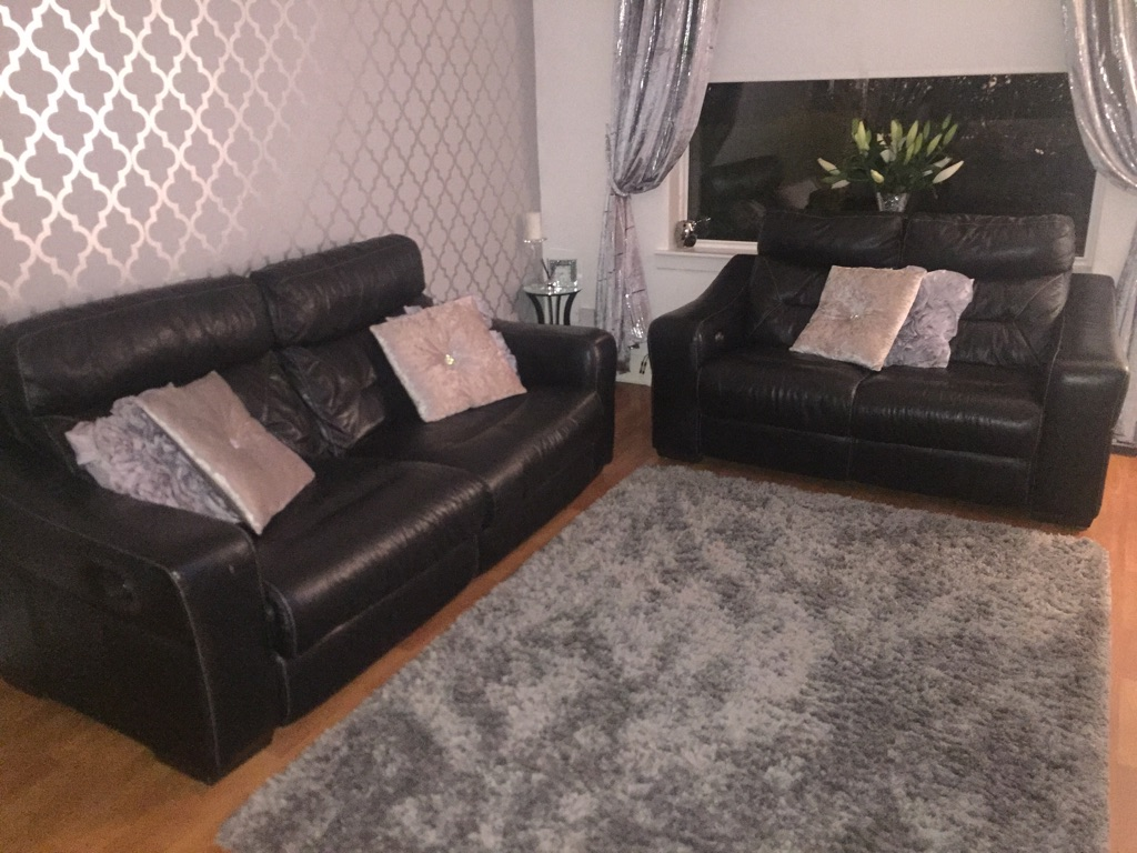 Black Italian leather 3 and 2 seater recliner couch