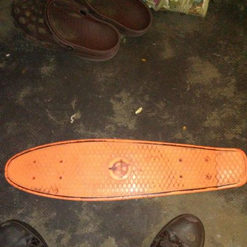 Orange penny cruiser board/LOTS of skateboard too