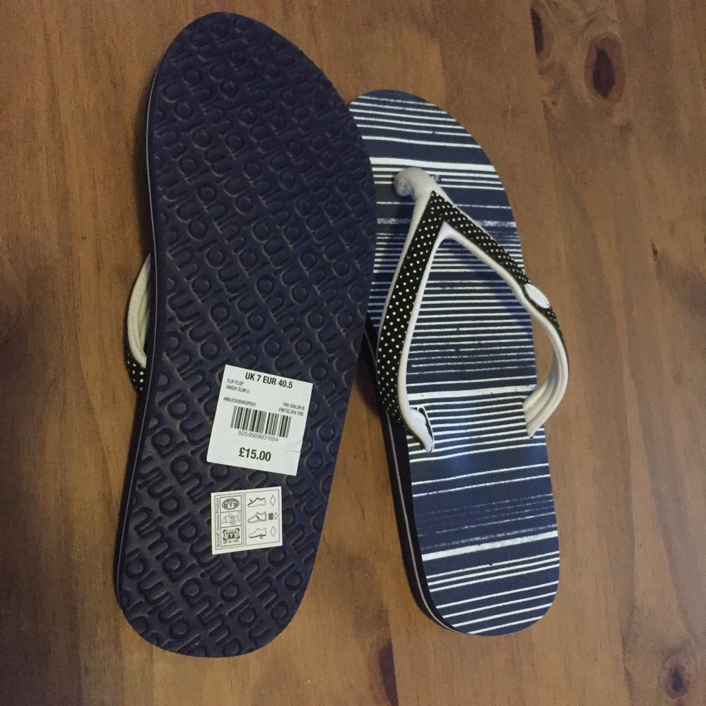 Brand new Animal Flipflops size 7