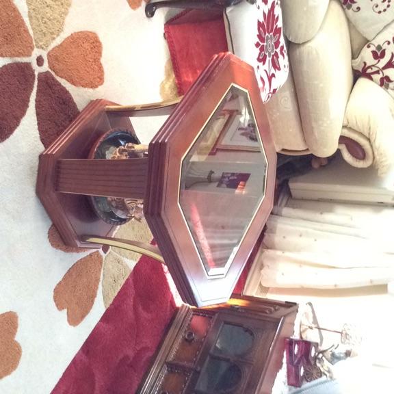 Coffee table,bottom shelf,glass top,on casters.
