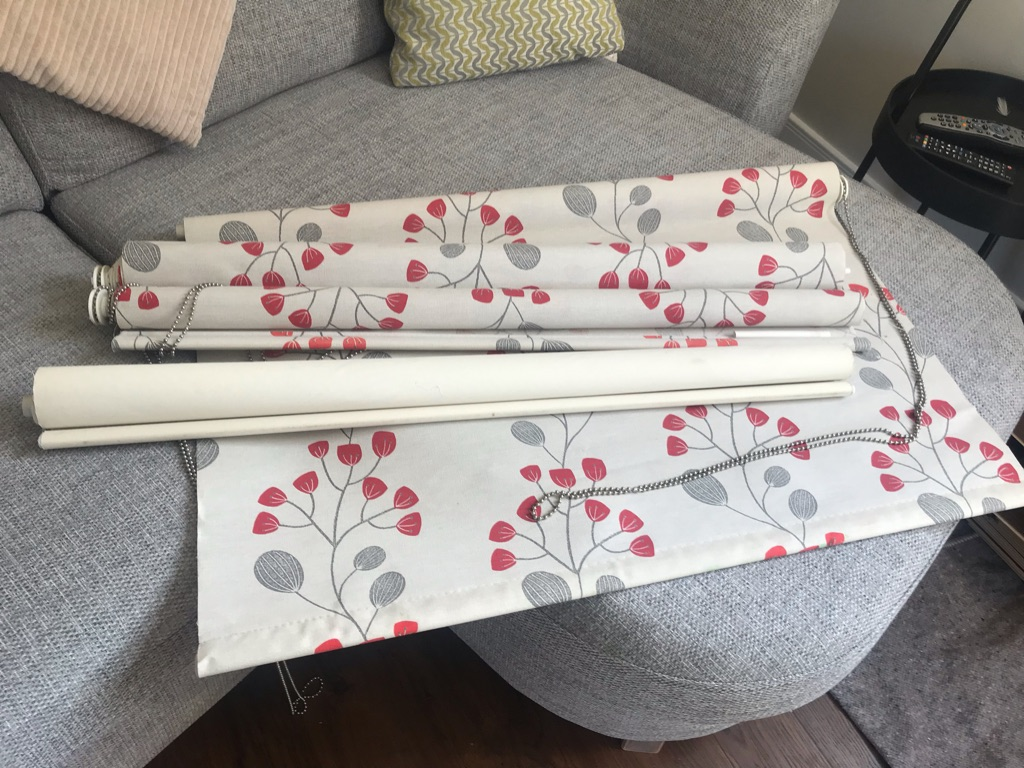 3 flower blinds and a blackout blind