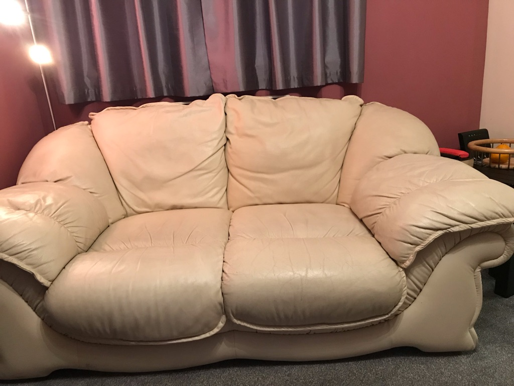 Two-seater cream leather sofa