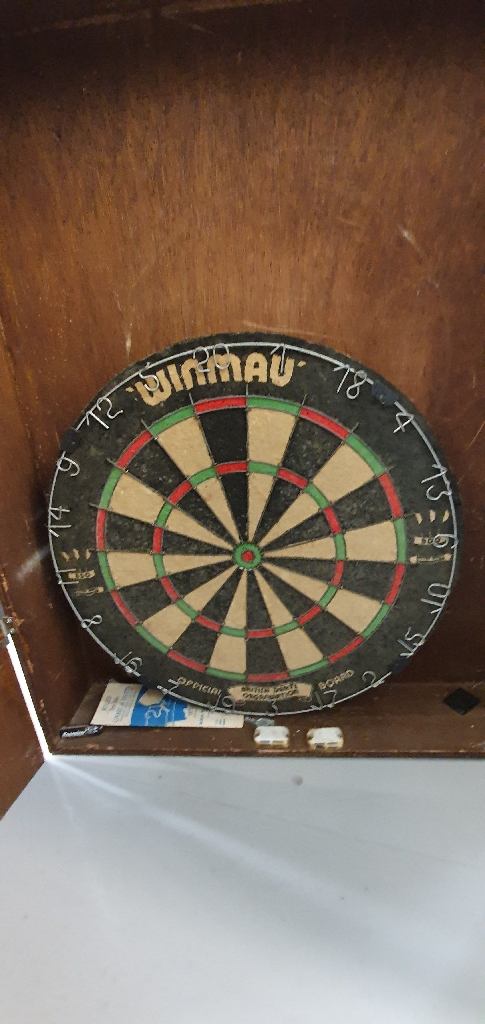 Dartboard with cabinet and darts