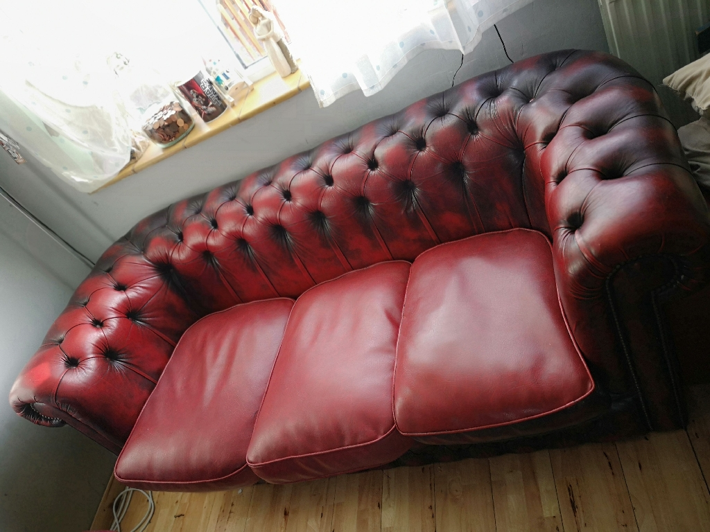 Suite of Chesterfield sofa and club chairs