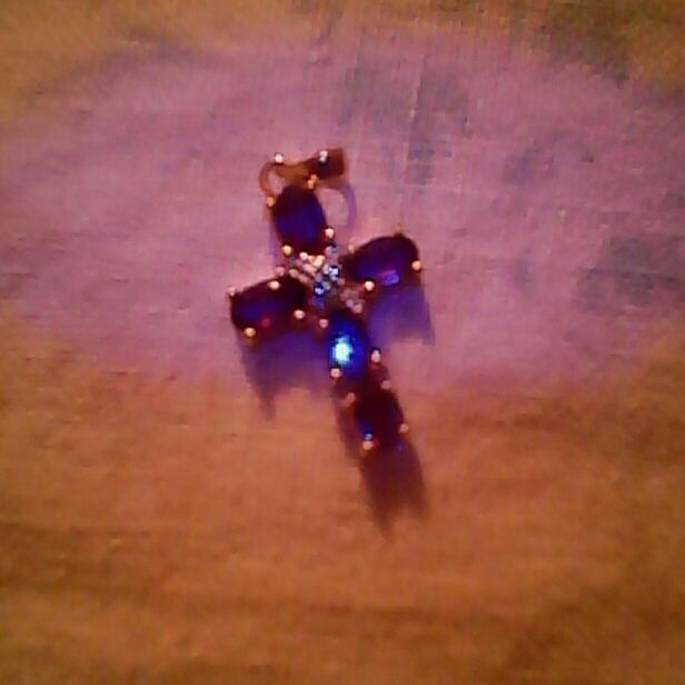Genuine Amethyst Cross with Diamond center stone  $20.Firm