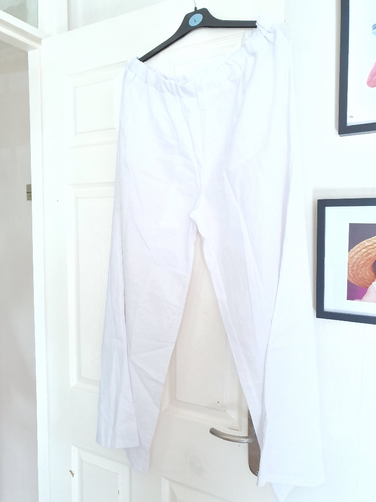 White wide trousers and brown blouse