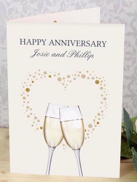 Personalised 'gold champagne flutes' greeting card