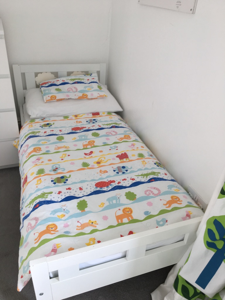 White, Ikea toddler bed with 2 sets of bedding