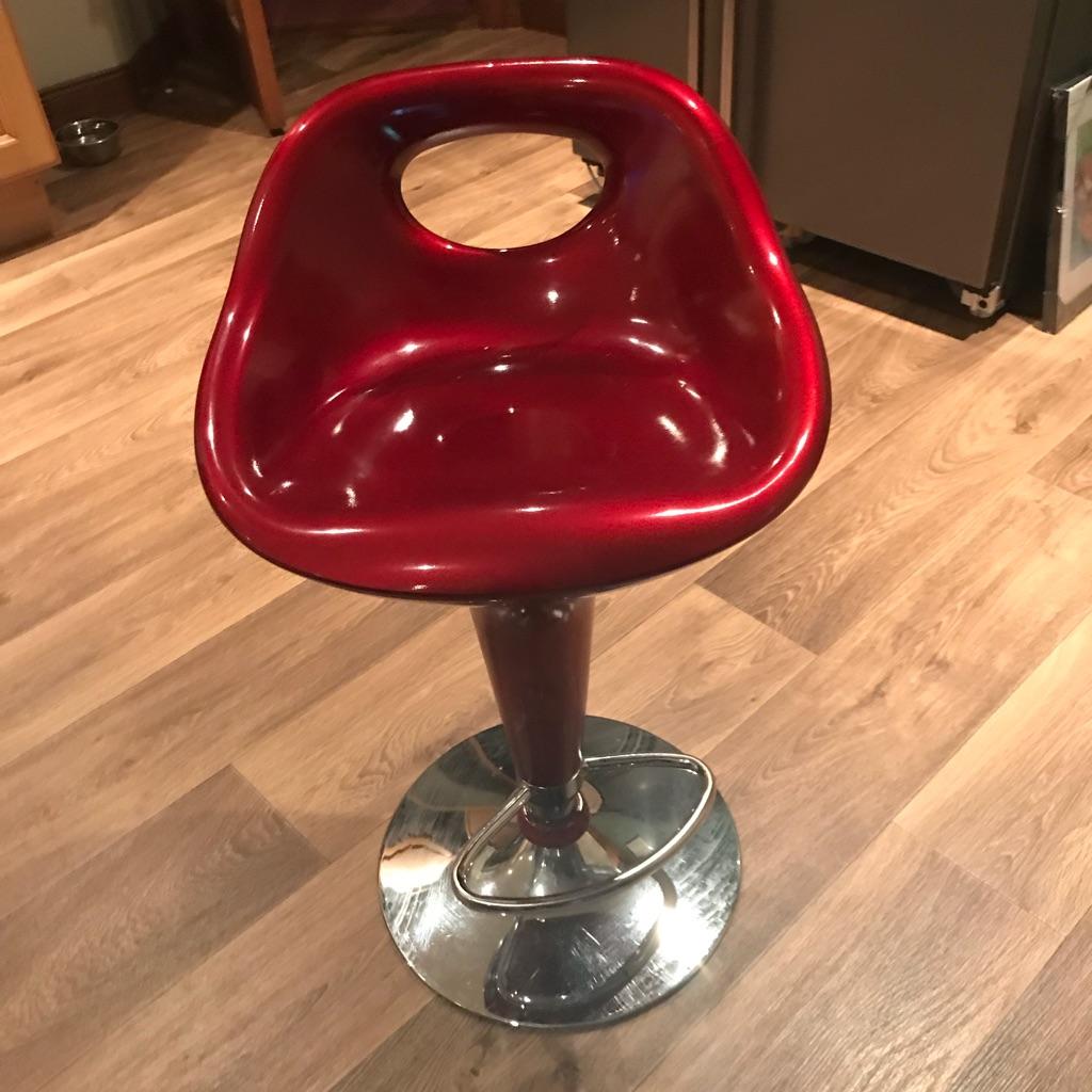 Three beautiful red bar stools