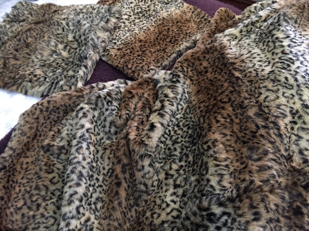 Animal print faux fur throw and two cushion covers