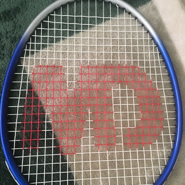Pair of Badminton Raquets