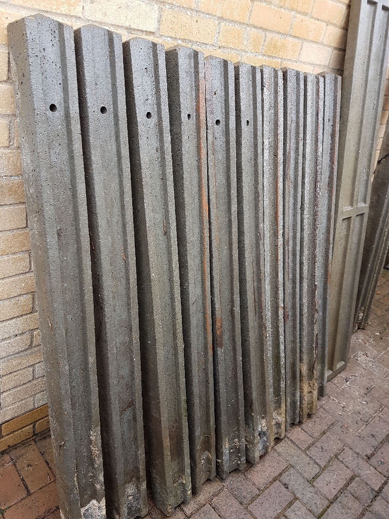 Concrete fence posts and panels