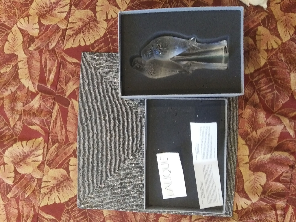 1999 Lalique Two Parakeets Crystal Figurine  Measures in height 7.5 inches & base 2.25 inches. Item is signed at bottom of base - Lalique {R} France  No chips or cracks. Item was never used - collectable - stored in Original Box.  Signatured shipping required. No returns!!!  Can shine different colored lights on and tbrough them to get amazing effects. These crystals are amazing if you light them