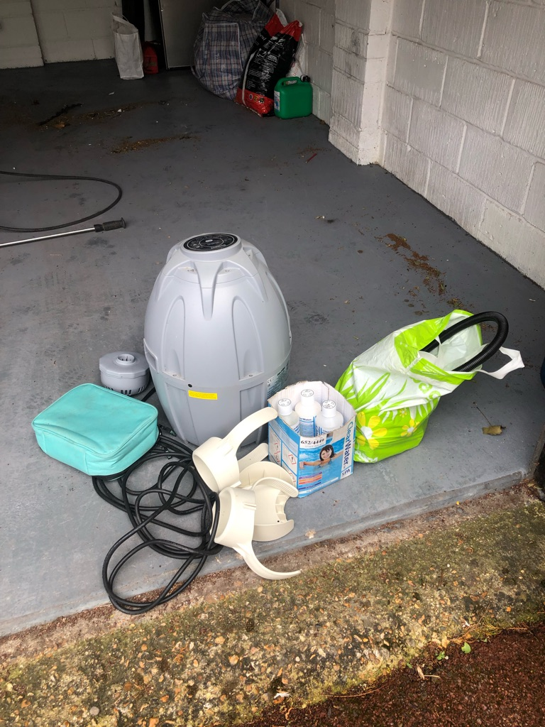 Lazy spa pump, cover and chemicals.