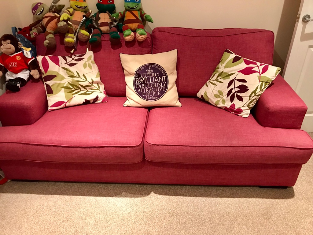 Fuschia Sofa With Matching Curtains And Cushions