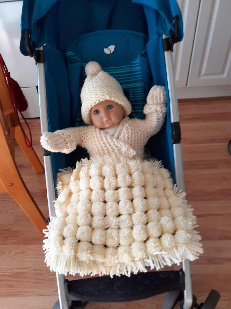 Handmade knitted dolls sets and pompom blankets each