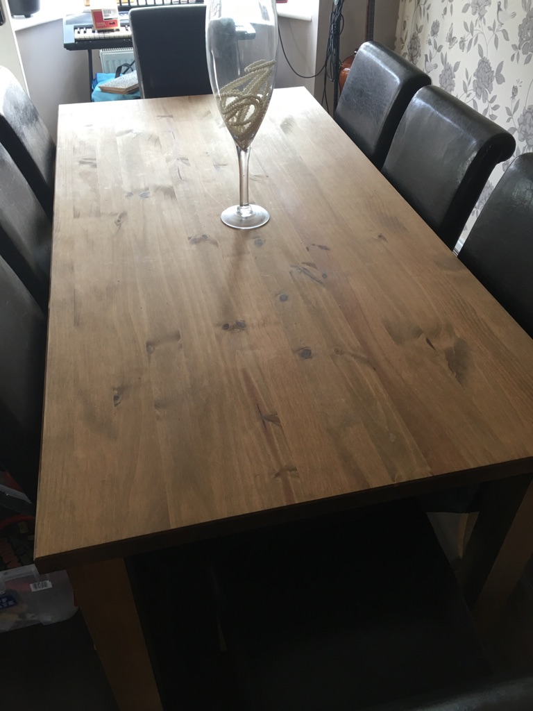 Wooden table with 8 brown chairs