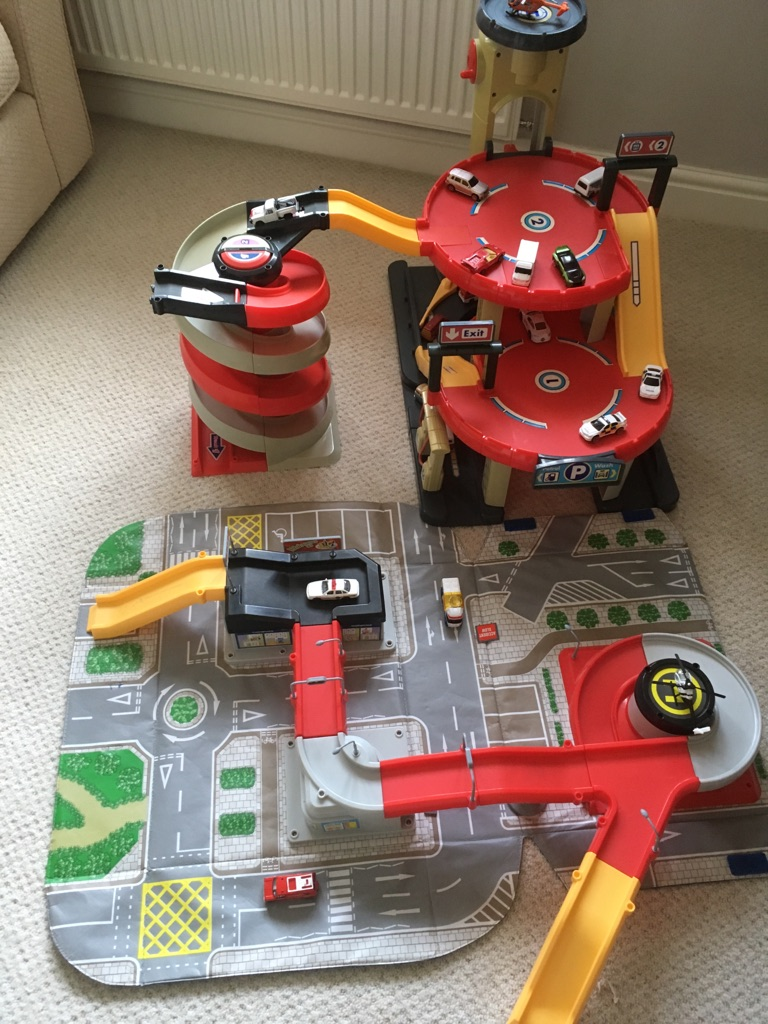 Big city garage with spiral race track and play mat