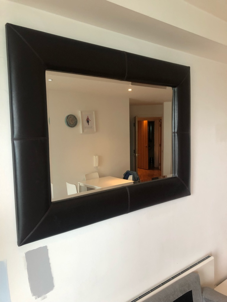 Mirror with leather frama