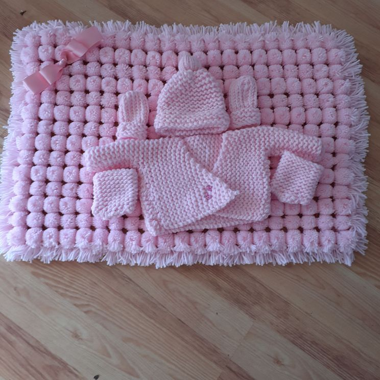 Handmade knitted pom pom and knitted set package