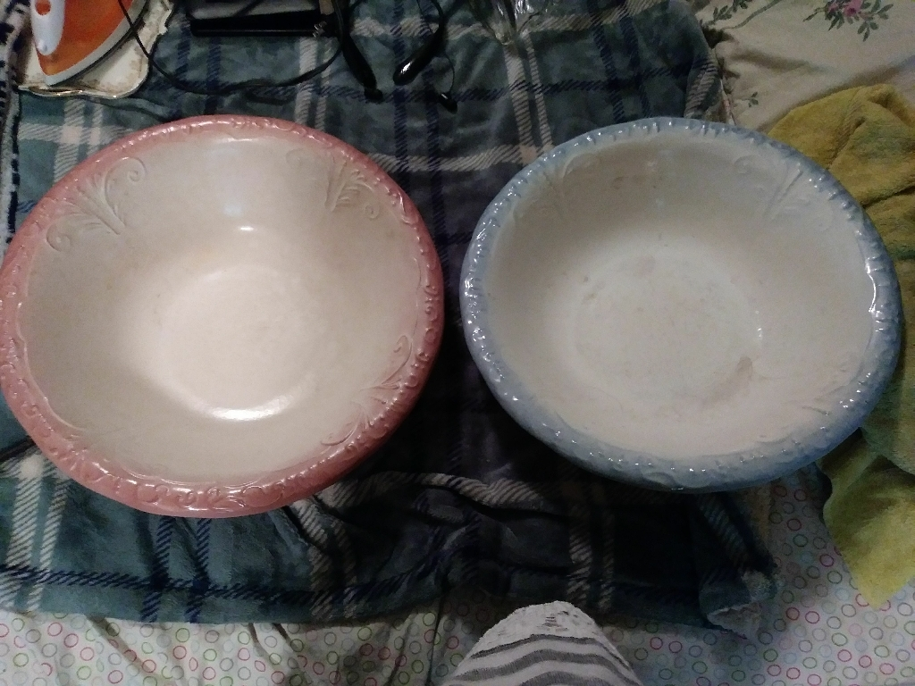 His & hers water basin with pitchers
