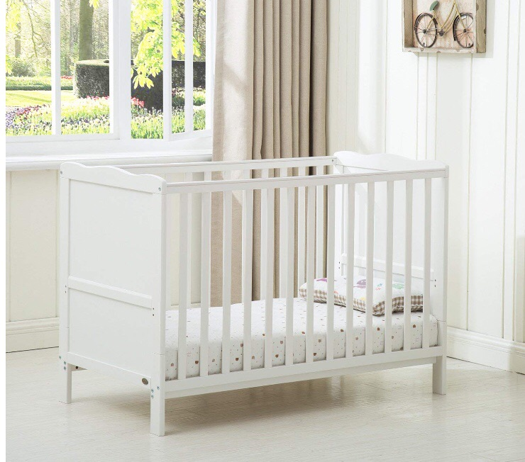 Toddler bed frame with mattress.