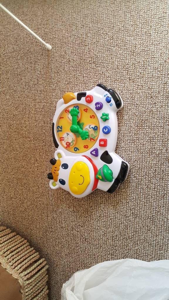 child's toy cow clock