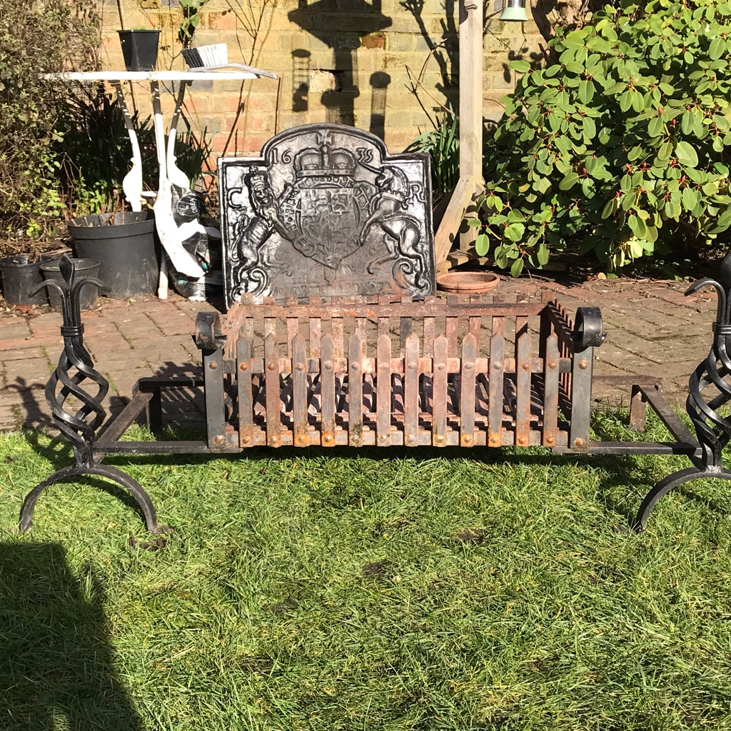 Cast iron grate and fire dogs