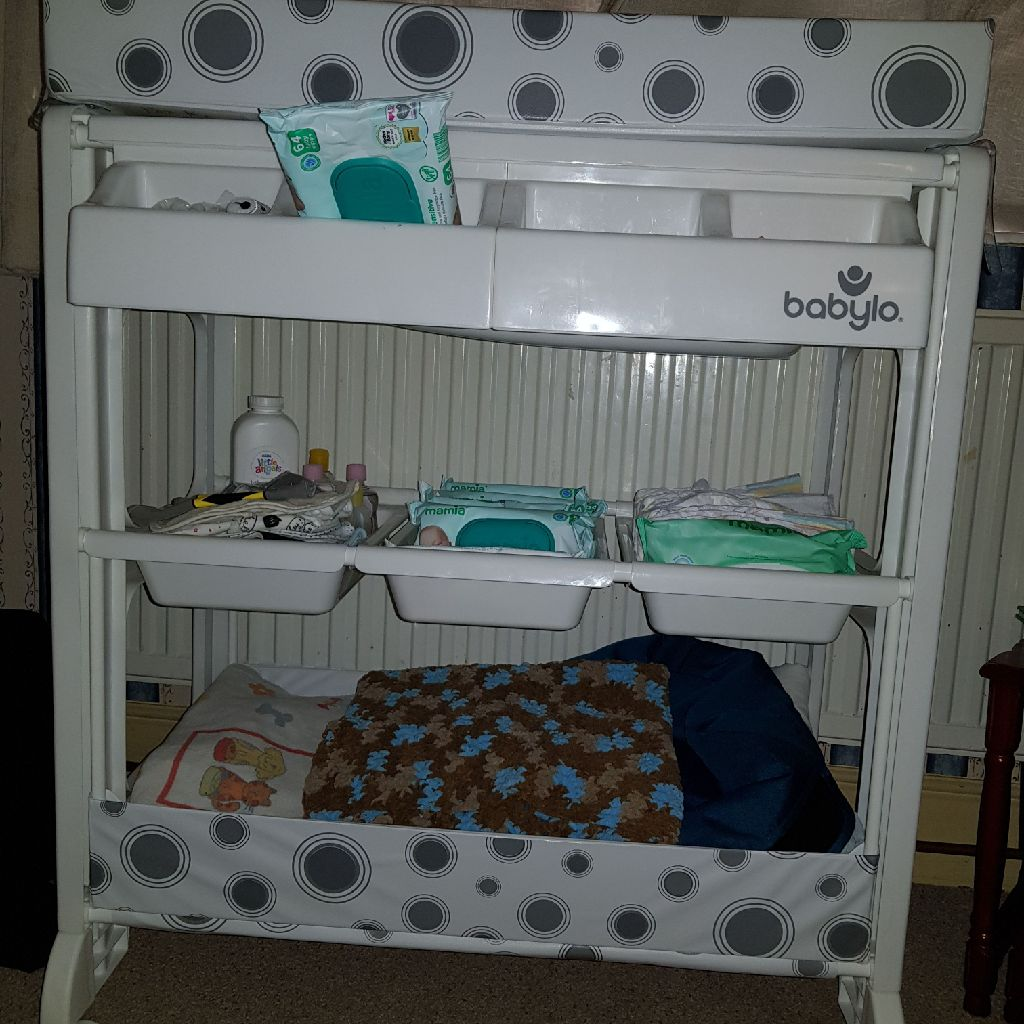 Baby changing unit with storage.