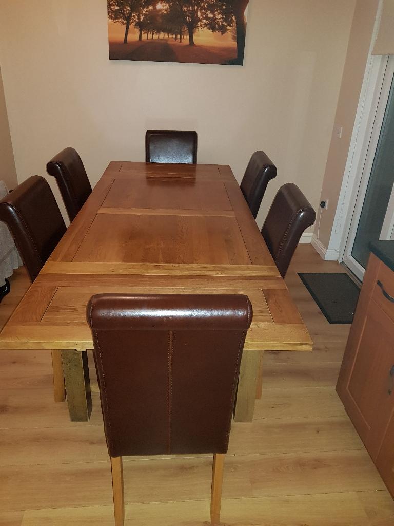 Extending oak dining table set