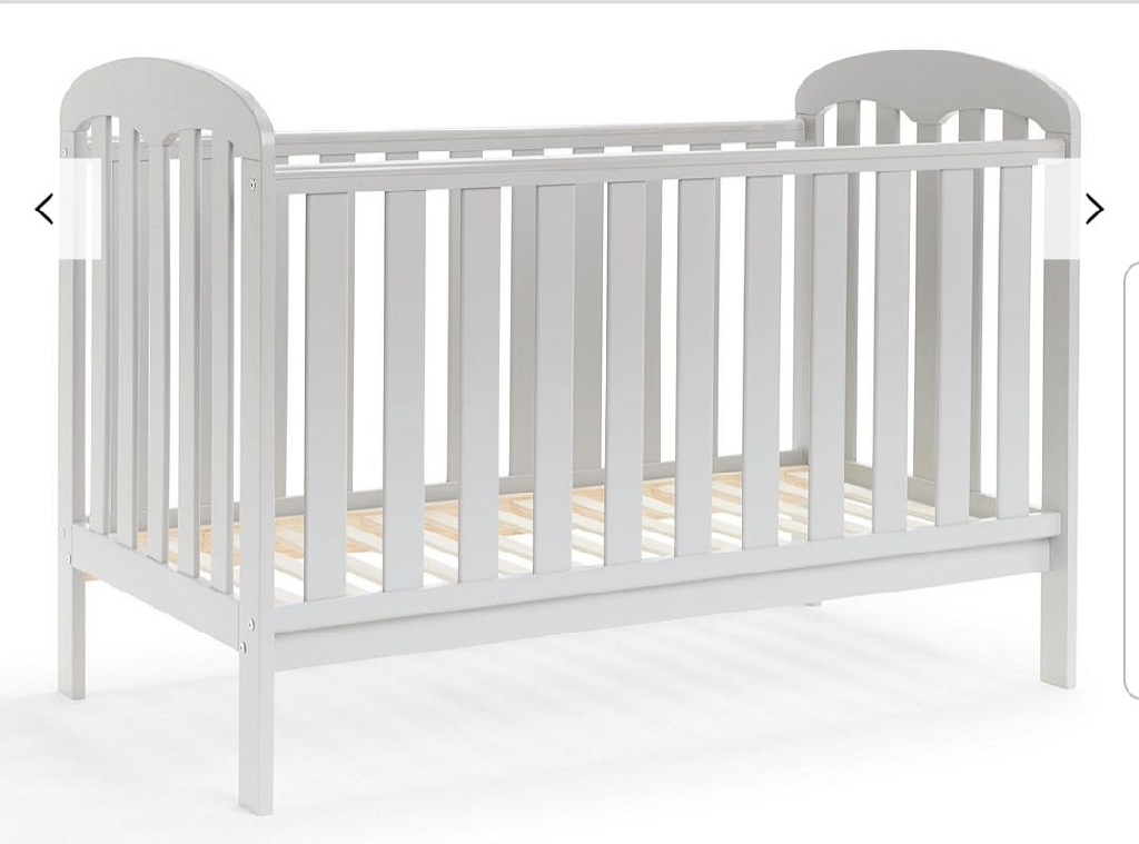 John Lewis cot bed white with mattress and a nappy bin
