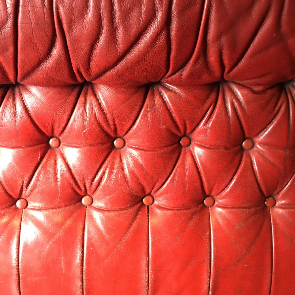 Leather sofa - red Chesterfield style buttons