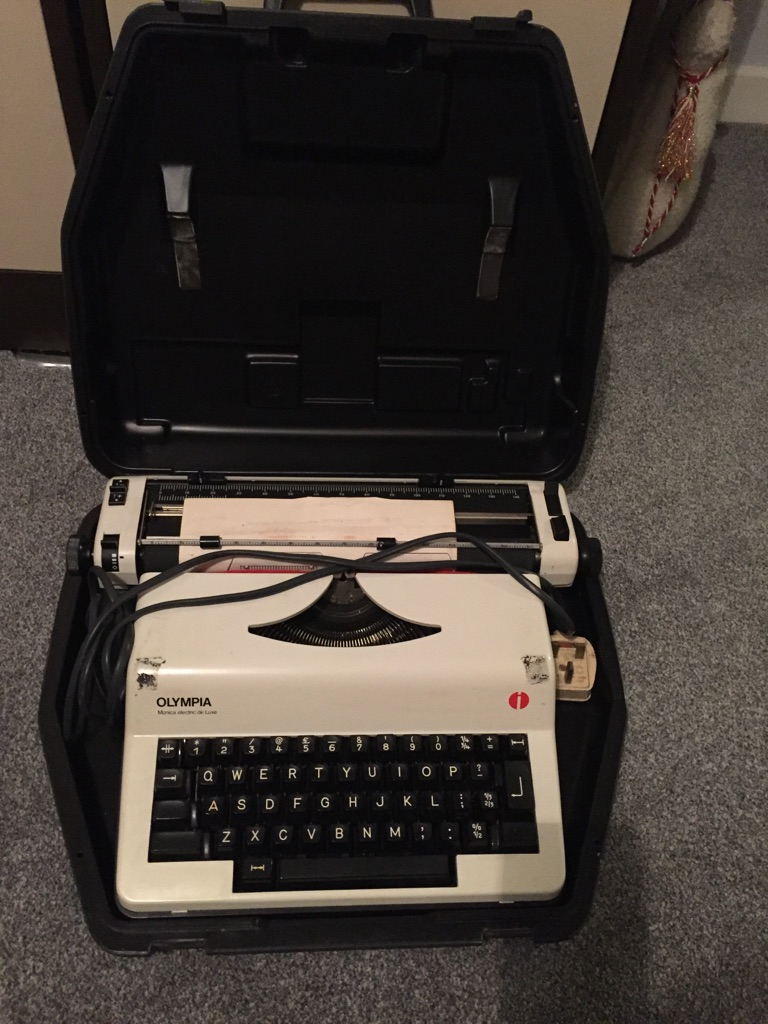 Antique Electric Typewriter Olympia with lead
