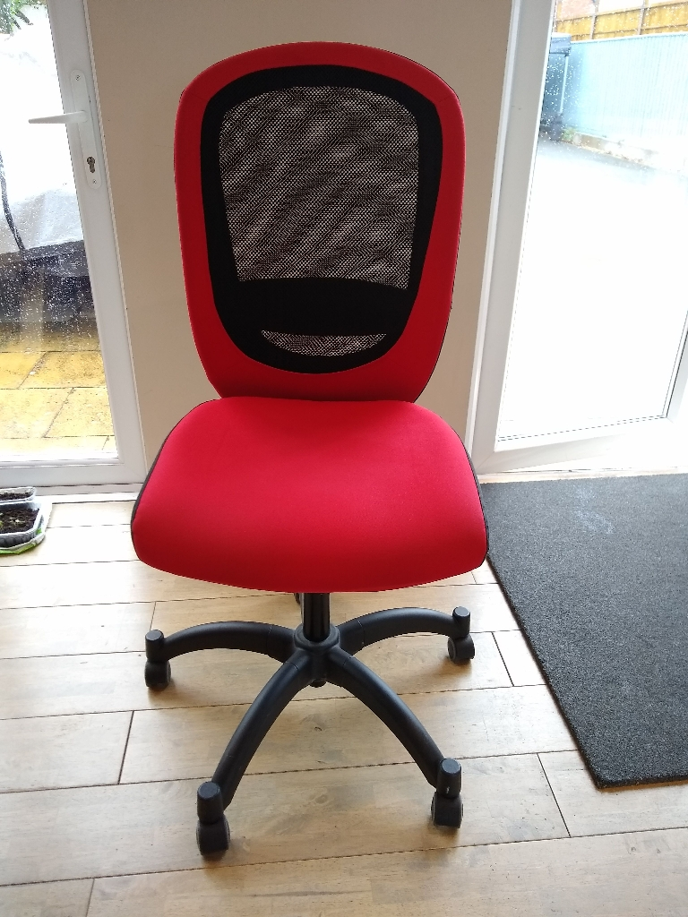 Red and black swivel office chair