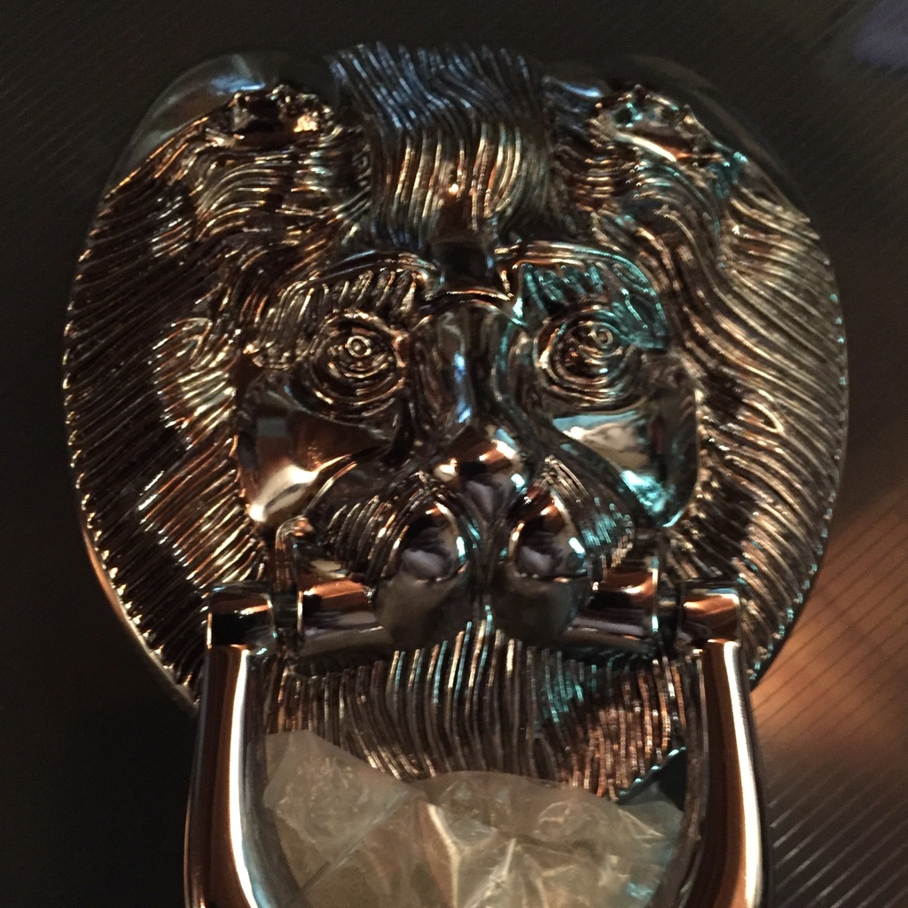 Brand New Chrome Lion head Door knocker.
