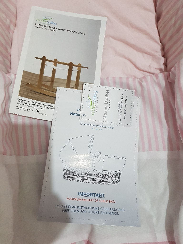 Pink Moses basket with white rocking stand