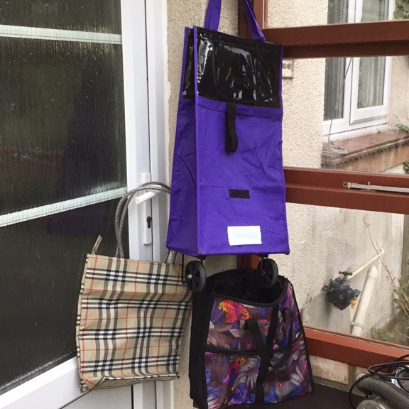 Collection of shopping bags, one wheeled
