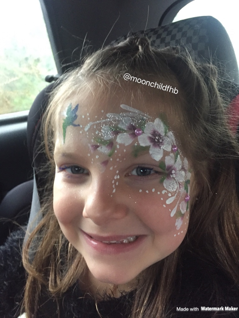 Facepainting glitter tattoos and hair braiding