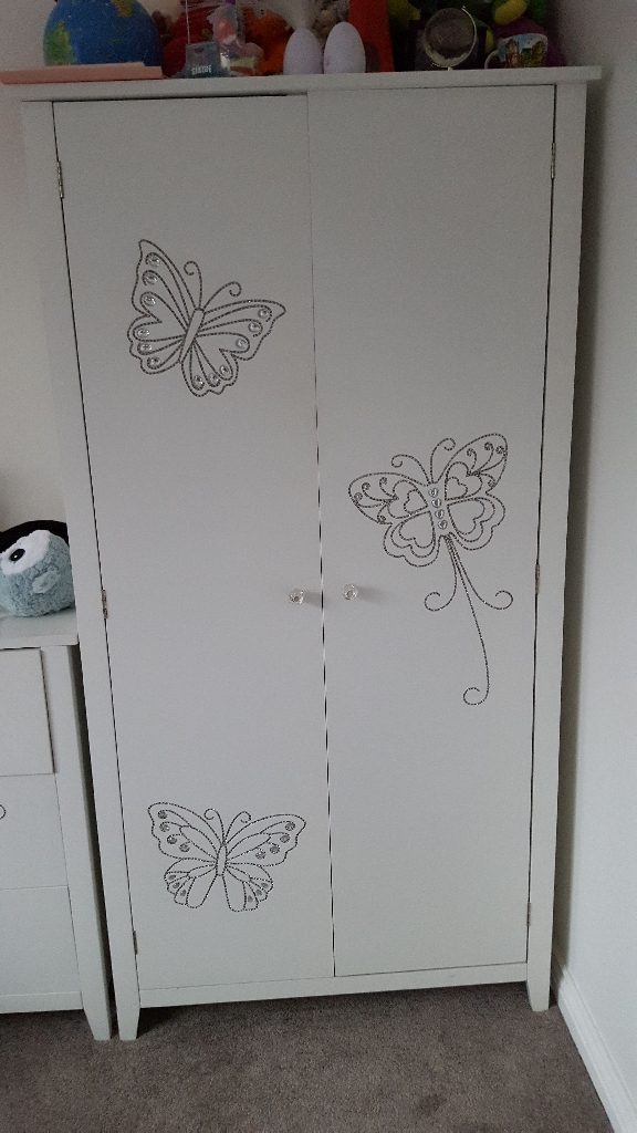 Wardrobe nad chest of drawers with crystal butterfly
