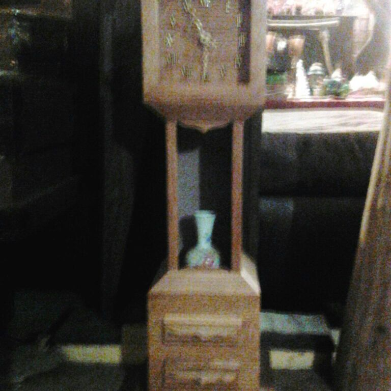 Folk art. Small wooden clock