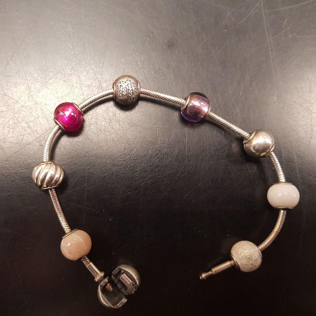 Pandora essence bracelet with charms