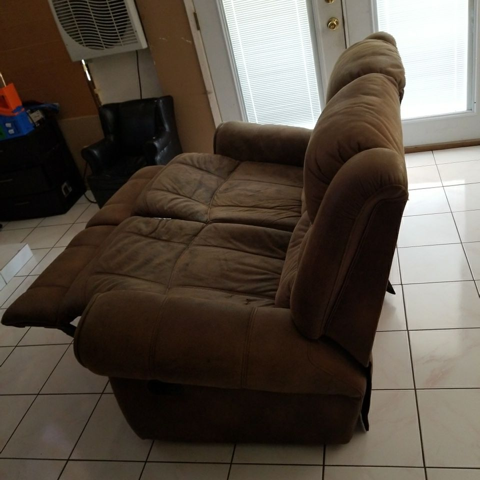 BROWN RECLINER MAETRIAL LOVE SEAT HAS A FEW STAINS FROM JUICE ONE SMALL HOLE IN ONE SEAT  NO SMOKING IN IT NO PET HAIRS  $100.00